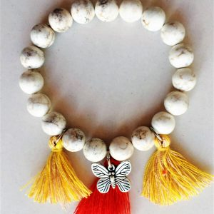 IVORY BRACELET WITH CHARM NATURAL STONES & TASSELS